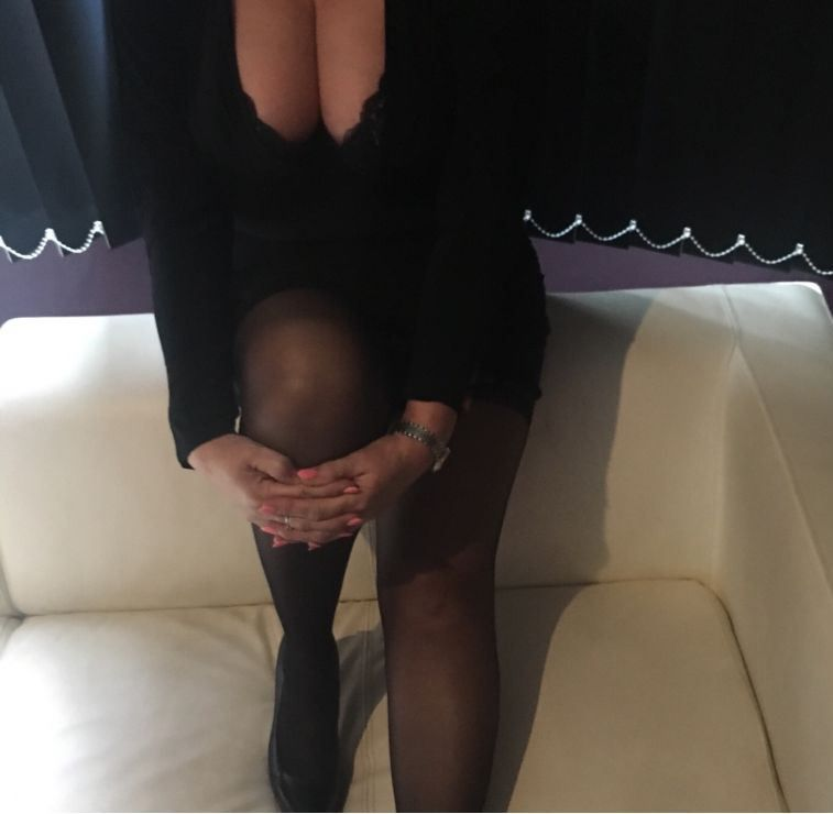 Classy sexy extremely busty milf